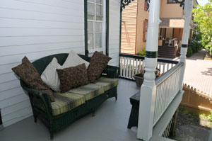 Outdoor sofa on the covered porch